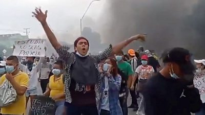 A man waves his arms at a Colombian protest.