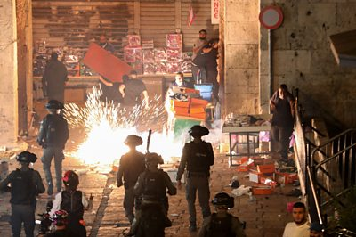 Israeli police, Palestinians and a stun grenade exploding