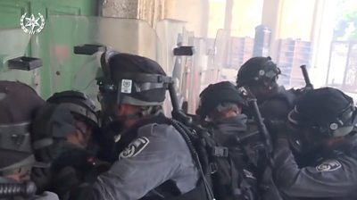 Israeli Police at the door to the  Al-Aqsa mosque