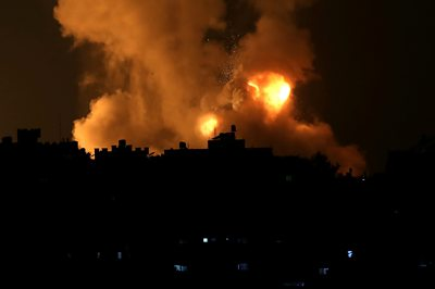 Smoke and flames rise above Gaza strip