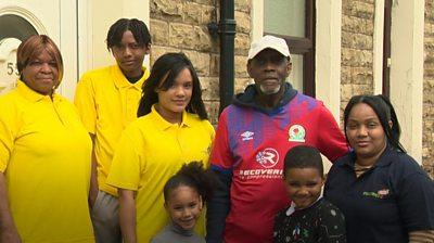 Blackburn family in street