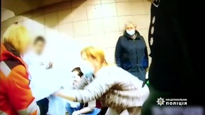 People help a woman giving birth in the Kyiv metro