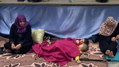 Gazans in a shelter