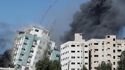 Gaza tower block collapsing