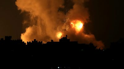 Smoke and flames rise above Gaza Strip