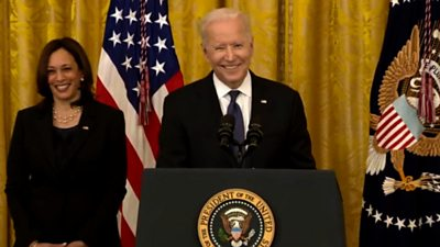 Presidential bill signings have always been stately occasions. So how did Joe Biden react when his White House ceremony was interrupted by a very modern breach of etiquette?