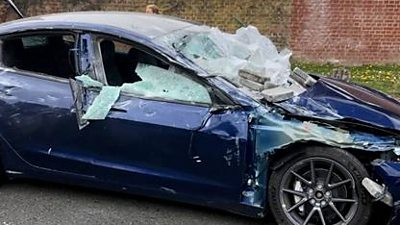 The couple escape almost unscathed as the slabs fell on to the car windscreen, bonnet and roof.