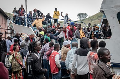 Goma residents are seen boarding a ferry after an evacuation order has been given on May 27, 2021