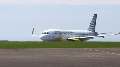Plane at Cardiff Airport runway