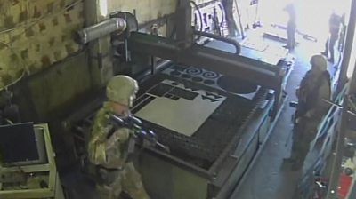 Troops mistakenly raid factory
