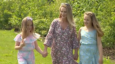 Suzie Vaughan and her daughters