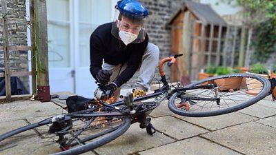 Tom Brada uses an angle grinder to test an anti-theft bike lock device