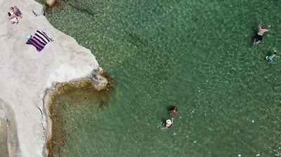Aerial view of people in the sea