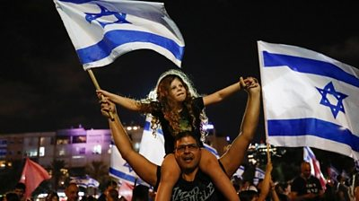 Many Israelis celebrate as a new coalition government ends 12 years of Benjamin Netanyahu.