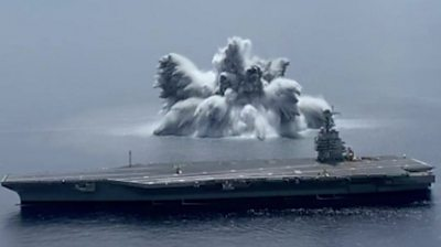 An explosion under water next to the USS Gerald R. Ford
