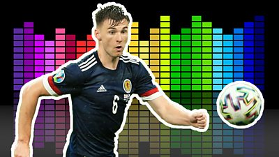 Kieran Tierney chases the ball in front of a multi-coloured music equaliser