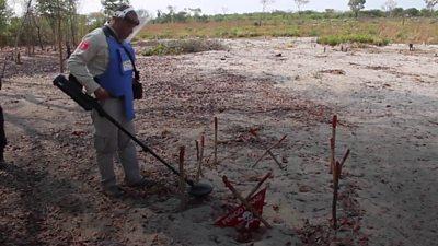 A man hunts for mines manually