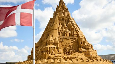 Sandcastle and the Danish flag