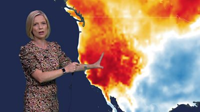 Weather presenter Sarah Keith-Lucas standing in front of a heat map of the western USA