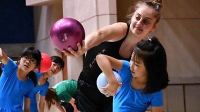 Gymnast and children