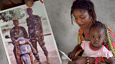 Malian soldiers and a mother and child