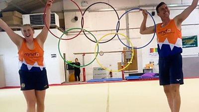 Charlotte and Stuart pose with their own Olympic rings