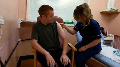 Adam with nurse