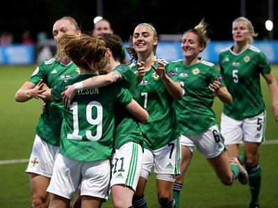 Emily Wilson celebrates scoring a goal with teammates