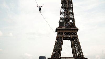 Slackliner Nathan Paulin walking in front of Eiffel Tower