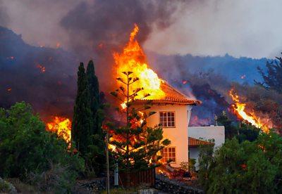 Lava burns a house in La Palma
