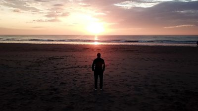 Migrant on beach
