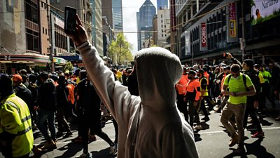 Man walks in Melbourne protest