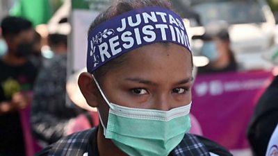 A protester from El Salvador looking at the camera