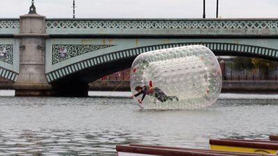 Man in the River Lagan in a bubble