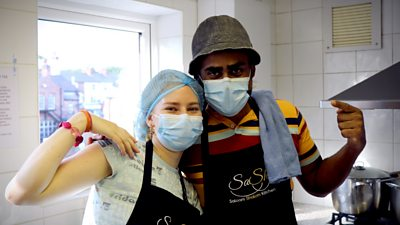 Two volunteers at Salaam Shalom Kitchen