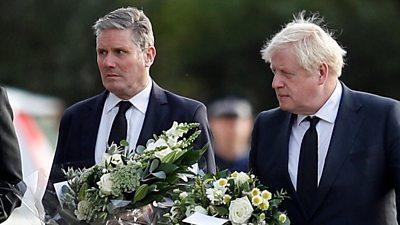 Sir Keir Starmer and Boris Johnson hold flowers in Leigh-on-Sea, 16 October 2021