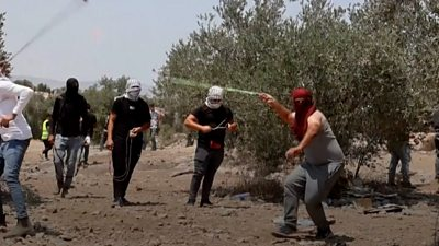 Protester wearing a mask throwing rocks