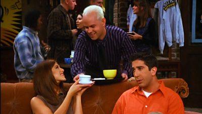 Gunther hands Rachel a coffee in Friends