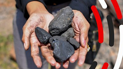 Lumps of coal in a pair of hands
