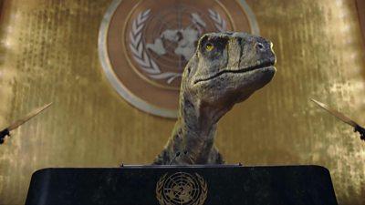 Dinosaur at podium