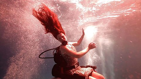 The woman making her wheelchair scuba-dives into art