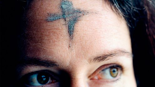 Ashes cross on the forehead of a Christian woman on Ash Wednesday 2008