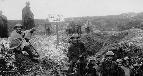 British troops pose at a captured German position in WW1