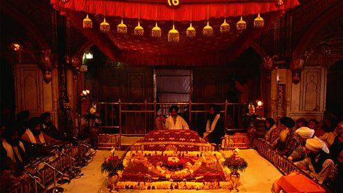 Reading from the Guru Granth Sahib inside the Golden Temple at Amritsar