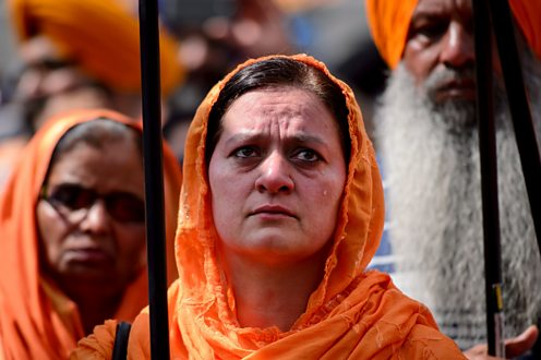 A Sikh woman cries during a demonstration in central London on June 8, 2014
