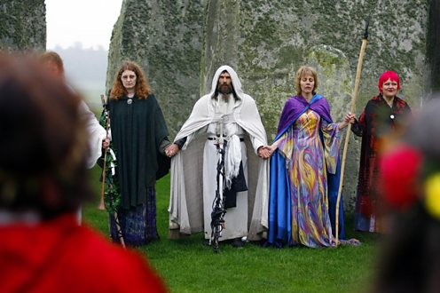 Druids performing a Samhain style blessing at Stonehenge, Wiltshire
