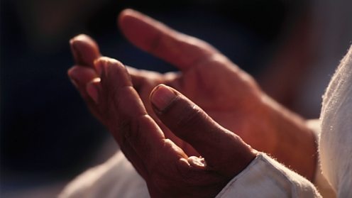 Hands of Muslim man praying