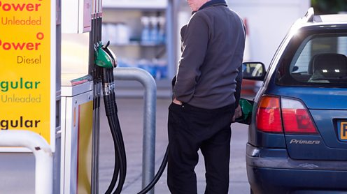 A man fills up his car at a petrol station in 20014. Bloomberg.