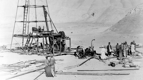 Workers for the Anglo Iranian Oil company operate a derrick, Persia. Hulton