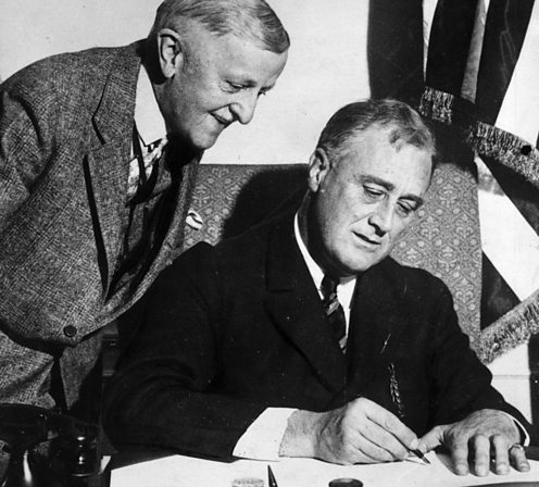 Franklin D. Roosevelt signs the Emergency Banking Bill